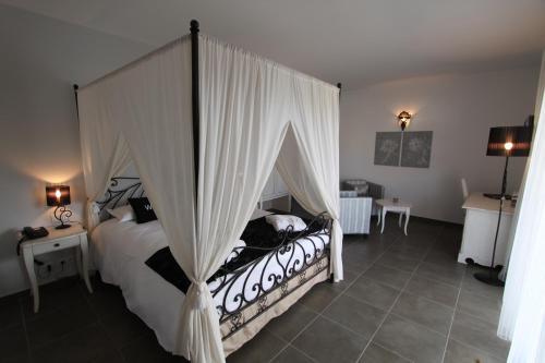 Un ou plusieurs lits dans un hébergement de l'établissement Hôtel A Madonetta