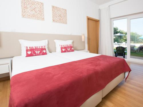 A bed or beds in a room at Tavira Monte