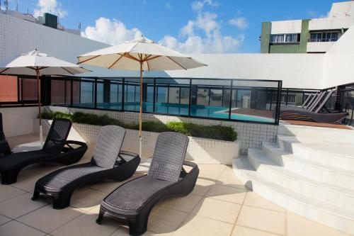A patio or other outdoor area at Palms Ponta Verde by Tropicalis