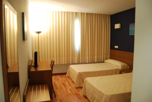 Una habitación en Hotel Area de Servicio Los Chopos
