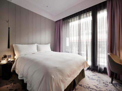 天雲旅棧台北基河館房間的床