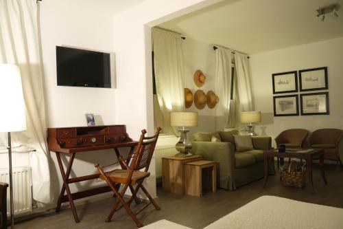 Ein Sitzbereich in der Unterkunft Bergland Hotel - Adults only