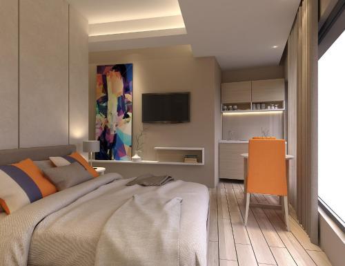 Телевизор и/или развлекательный центр в Twister Apartments