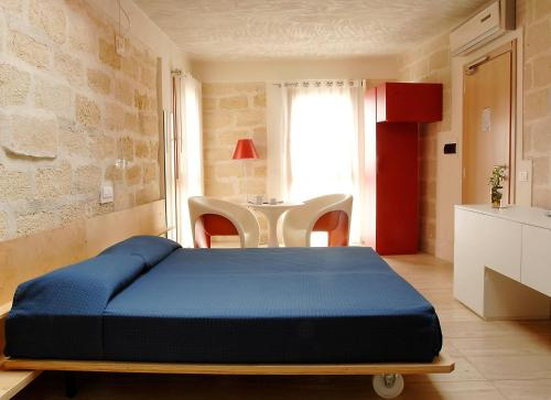 A bed or beds in a room at Cave Bianche Hotel