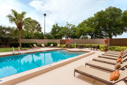 The swimming pool at or near Embassy Suites by Hilton Orlando International Drive ICON Park