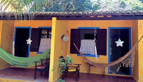 Uma varanda ou outra área externa em Pousada Vila Santapipa