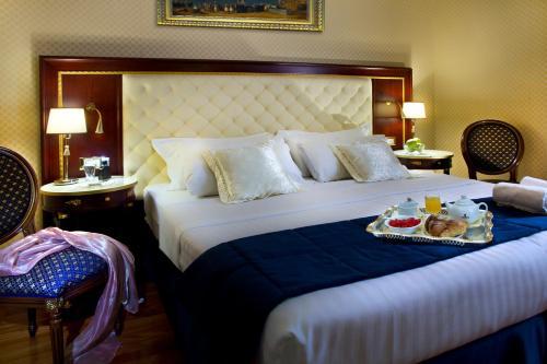 Letto o letti in una camera di Hotel Mondial
