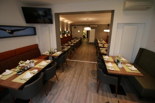 A restaurant or other place to eat at Hotel zum Adler - Superior