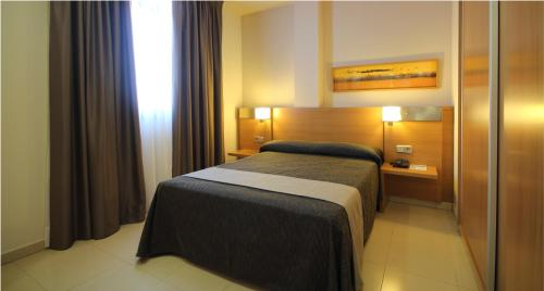 Een kamer bij AQUA Hotel Nostre Mar Apartments