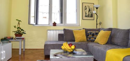 O zonă de relaxare la Regina's Central Street Apartment