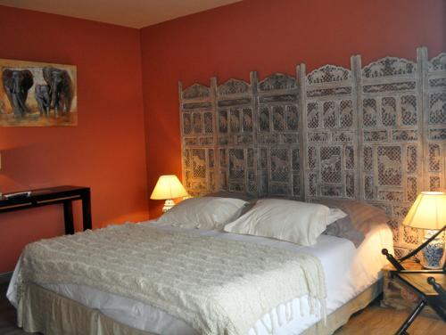 A bed or beds in a room at La Villa Florida