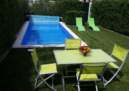 The swimming pool at or near White Bougainvillea House