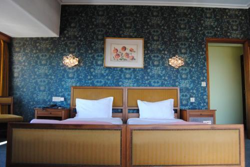 Кровать или кровати в номере Hotel Miradouro