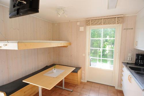 En tv och/eller ett underhållningssystem på Apelvikens Camping & Cottages