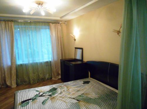 Кровать или кровати в номере Apartment on Lomonosova