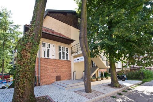 The facade or entrance of Navy Group - Port Sopot