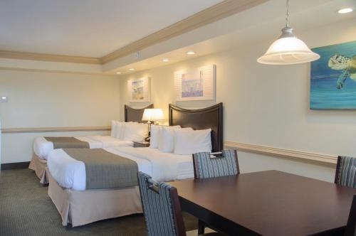 A bed or beds in a room at Shutters on the Banks