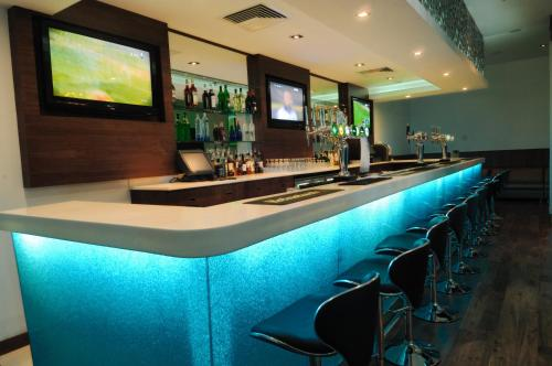 The lounge or bar area at Dragon Hotel And Resort