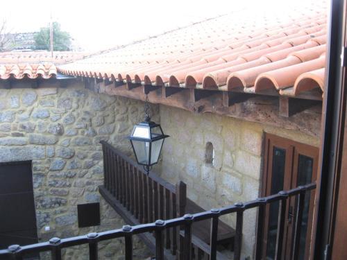 A porch or other outdoor area at Casa do Castelo de Celorico