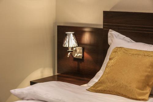 Um quarto em Al Itqan Apart-hotel