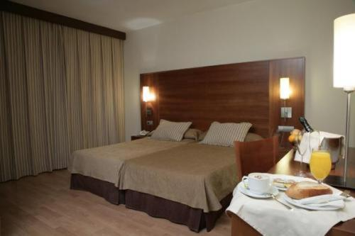 A bed or beds in a room at BS Capitulaciones