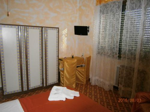 Телевизор и/или развлекательный центр в Albergo Il Cantuccio