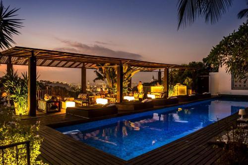 The swimming pool at or near Santa Teresa Hotel RJ - MGallery
