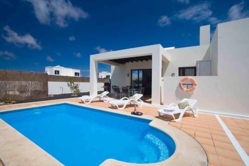 Het zwembad bij of vlak bij Ereza Villas Las Buganvillas