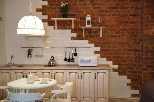 Кухня или мини-кухня в Studio on Gorokhovaya 32