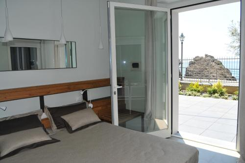 A bed or beds in a room at Roca Du Ma Pasu