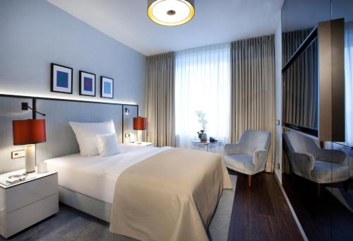 A bed or beds in a room at AMERON Bonn Hotel Königshof