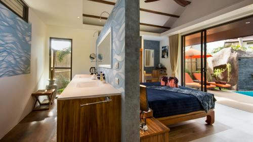 A bathroom at Khwan Beach Resort - Luxury Glamping and Pool Villas Samui - Adults Only - SHA Plus
