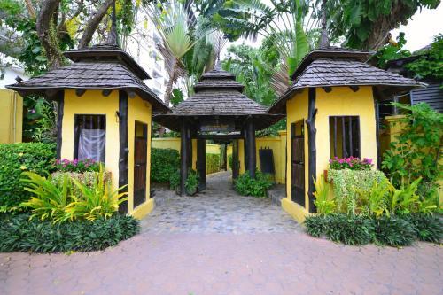 The facade or entrance of Supatra Hua Hin Resort