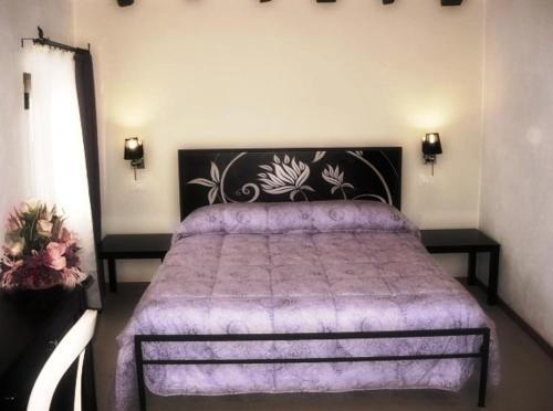 A bed or beds in a room at Villa Cittadella B&B