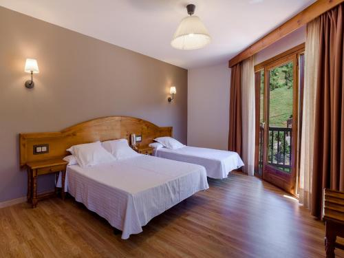 Cama o camas de una habitación en Hotel Sant Miquel
