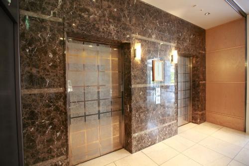 A bathroom at KKR Hotel Hakata