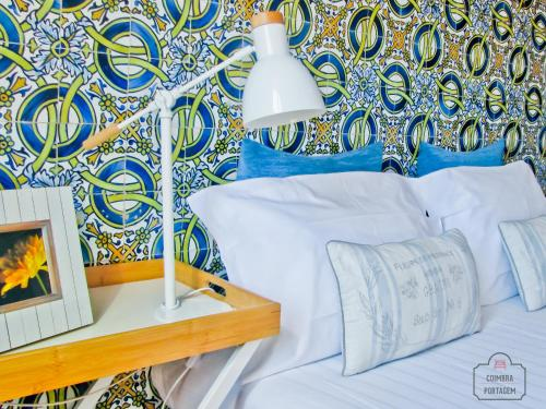 A bed or beds in a room at Coimbra Portagem Hostel