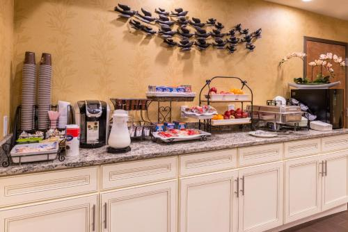A kitchen or kitchenette at Inn of The Dove Romantic Luxury & Business Suites
