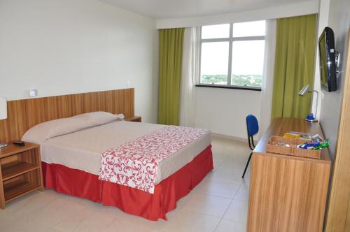 A bed or beds in a room at Boa Vista Eco Hotel