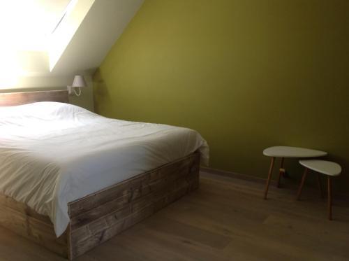 Ein Bett oder Betten in einem Zimmer der Unterkunft Kokkelikoo