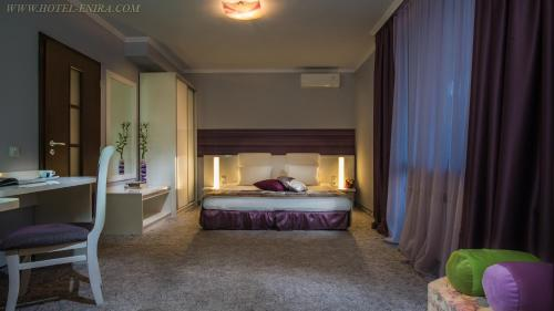 A bed or beds in a room at Enira Spa Hotel