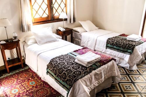 Una cama o camas en una habitación de Hotel Victoria Golf