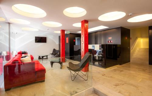 The lounge or bar area at Faro Boutique Hotel