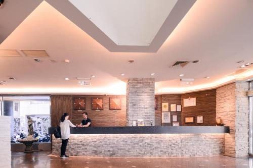The lobby or reception area at Waugh Den Business Hotel