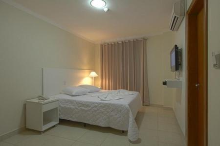 A bed or beds in a room at Skala Traveling Hotel