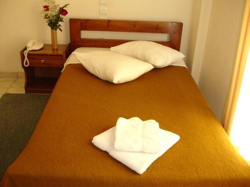Postel nebo postele na pokoji v ubytování Elite Hotel