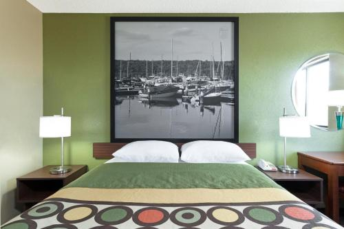 A bed or beds in a room at Super 8 by Wyndham Bath Hammondsport Area