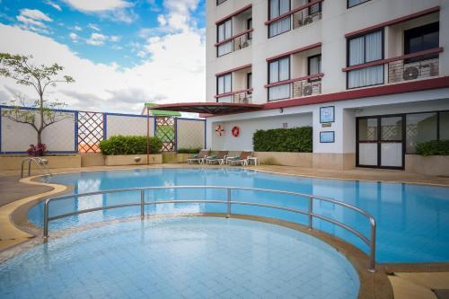 The swimming pool at or near Amora Thapae Hotel Chiang Mai