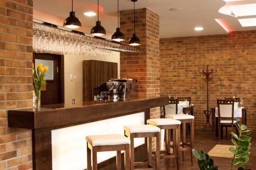 Reštaurácia alebo iné gastronomické zariadenie v ubytovaní Penzión Begálka