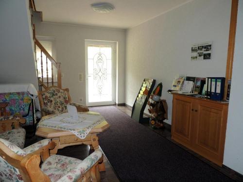 Lobby/Rezeption in der Unterkunft Gästehaus Am Hirtenberg